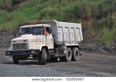 Poltava Region Ukraine - June 26 2010: Dump truck is turning around on the opencast mining site