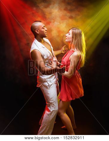 Young and sexy couple dances Caribbean Salsa