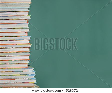 Tall stack of children's school books.