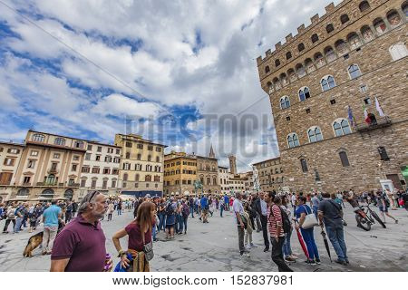FLORENCE, ITALY - SEPTEMBER 18, 2016: Unidentified people at Piazza della Signoria in Florence Italy. It is the focal point of the origin and of the history of the Florentine Republic.