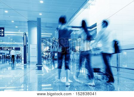 Passengers in the airport terminal motion blur movement.