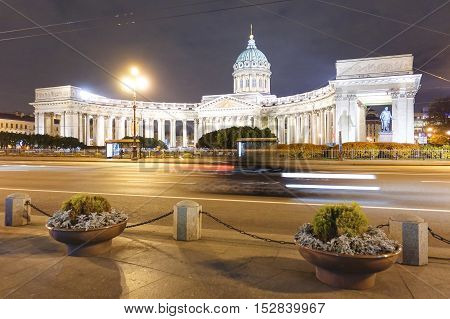 Speeding car ob the street with front view of Kazan Cathedral from the side of Nevsky Prospect in the world famous russian city of Saint Petersburg - Warm night color tones