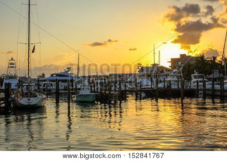Key West, Florida, United States - April 14, 2012: beautiful landscape of motor boats and sailing boat docked of Key West Harbor. Recreational boats for the sunset celebration.