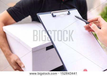 close up a tablet in woman hands with copy space