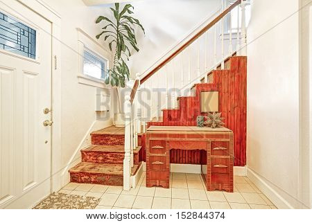 Entryway With Tile Floor, Staircase And Vintage Console Table