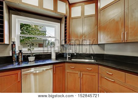 Close Up Of Kitchen Cabinets, Black Counter Top ,small Window