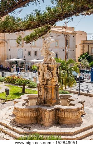 NOTO ITALY - SEPTEMBER 14 2015: Hercules fountain in Noto famed for its Baroque architecture. UNESCO World Heritage Site in Noto Sicily Italy.