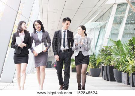business people talk in office in hongkong,asian