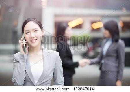 businesswoman talk on the phone in hongkong