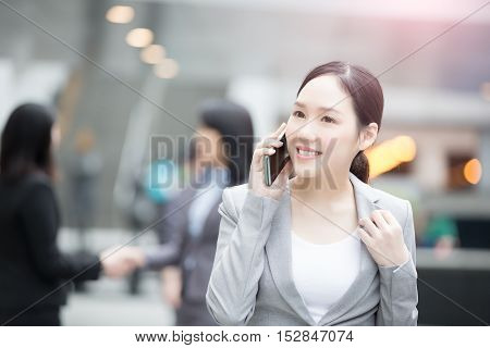 businesswoman talk on the phone in hongkong