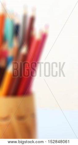 Color pencils for background unfocused. Colored object