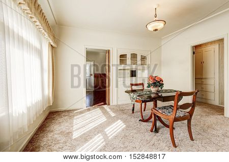 Interior Of Retro Style Dining Room With Carpet Floor