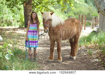 A cute little girl and her Icelandic Pony Friend.