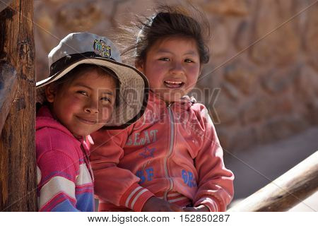 MACHU PICCHU PERU - September 03 2016: Peruvian kids in Machu Picchu site on September 03 2016. Machu Picchu Unesco World Heritage site and New 7 Wonder of the world.