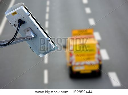 security CCTV camera or surveillance system with road highway on blurry background poster