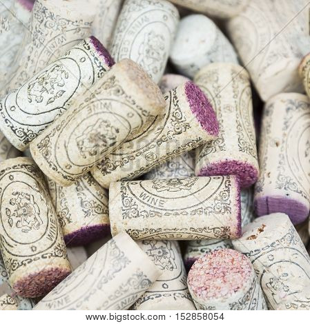 Used wine corks. Square image. A random selection of used wine corks. Closeup pattern background of many different wine corks.
