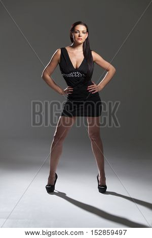 woman in a mini dress on white background