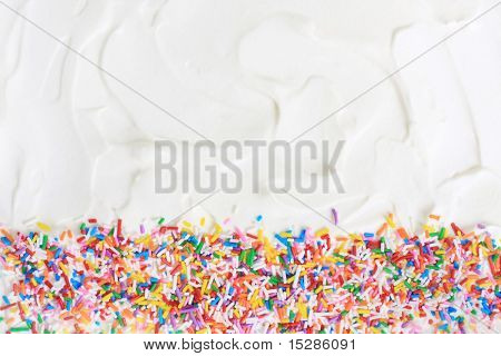Sugar sprinkles on a white icing background. poster