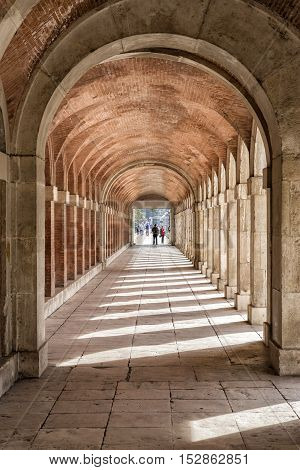 Aranjuez Spain - October 16 2016: Arches and passageway at the Palacio Real Aranjuez located in the Royal Site and town of Aranjuez Madrid province Spain