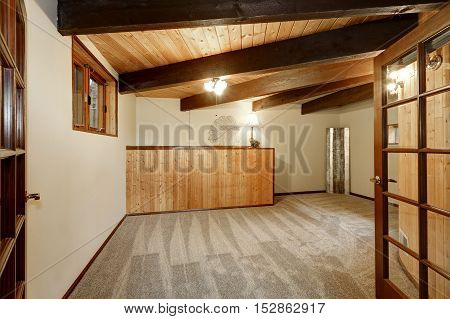 Wooden House Interior With Carpet Floor , Ceiling With Wooden Beams