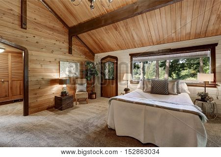 Wooden Bedroom Interior With High Beamed Ceiling