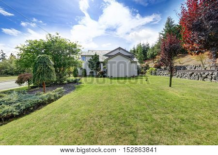 Luxury House Exterior With Well Kept Lawn