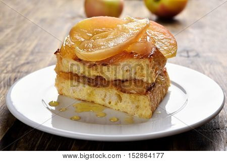 French toast stuffed with caramelized apples on white plate
