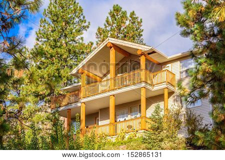the top of the house with nice window and balcony or veranda
