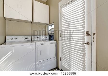 Small And Simple Laundry Room With Old-fashioned Appliances
