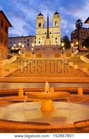 Spanish Steps with boat fountain illuminated at night, Rome, Italy