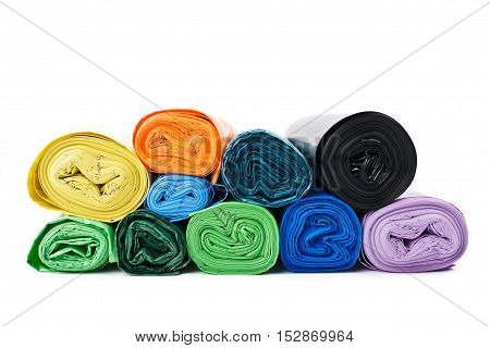 Many colored garbage bags on white background