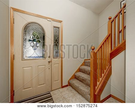 View Of Wooden Staircase And Tile Floor. House Entryway