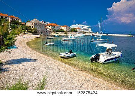 Beach and waterfront of Postira village Island of Brac Dalmatia Croatia