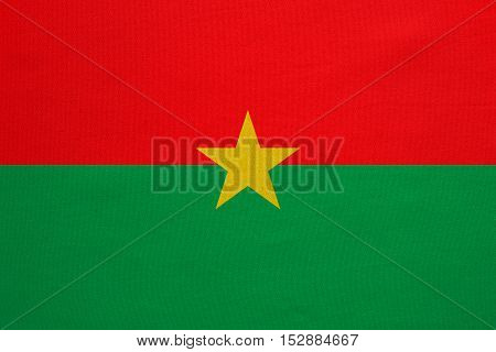 Burkina Faso national official flag. African patriotic symbol banner element background. Correct colors. Flag of Burkina Faso with real detailed fabric texture accurate size illustration