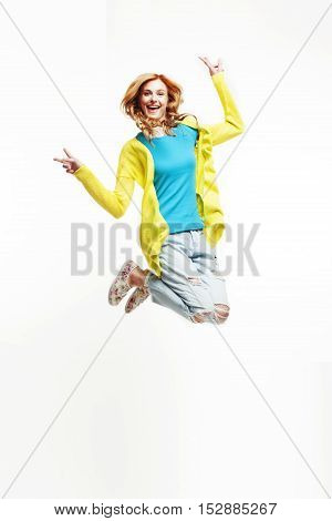 young pretty teenage girl jumping cheerful isolated on white background, lifestyle people concept close up