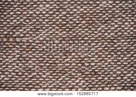 Macro flat view of woven undyed and brown wool surface