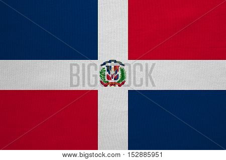 Dominican Republic national official flag. Patriotic symbol banner element background. Correct colors. Flag of Dominican Republic with real detailed fabric texture accurate size illustration