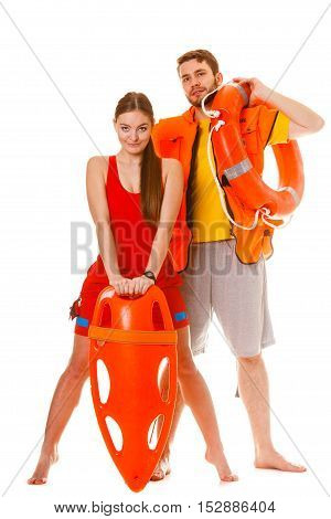 Lifeguards with rescue tube ring buoy lifebuoy and life vest jacket. Man and woman supervising swimming pool. Accident prevention.