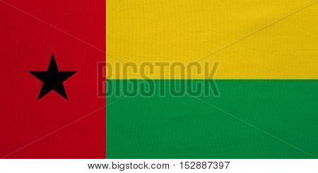 Bissau-Guinean national official flag. Patriotic symbol banner element background. Correct colors. Flag of Guinea-Bissau with real detailed fabric texture accurate size illustration
