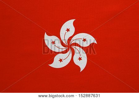 Hong Kongese official flag. Patriotic chinese symbol banner element background. Hong Kong is special region of PRC. Correct colors. Flag of Hong Kong fabric texture accurate size illustration