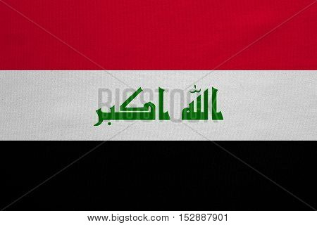 Iraqi national official flag. Irak patriotic symbol element background. Iraki banner. Correct colors. Flag of Iraq with real detailed fabric texture accurate size illustration