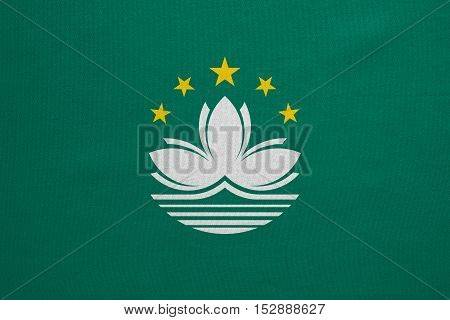 Macanese official flag. Patriotic chinese symbol banner element background. Macau is special region of PRC. Correct colors. Flag of Macau real detailed fabric texture accurate size illustration