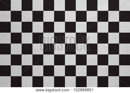 Checkered racing flag. Symbolic design of end of car race. Black and white background. Checkered flag with real detailed fabric texture accurate size illustration