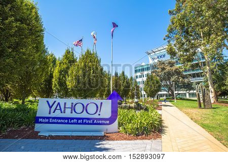 Sunnyvale, California, United States - August 15, 2016: flags in front of Yahoo Headquarters main entrance with American Flag and flag with Yahoo icon.