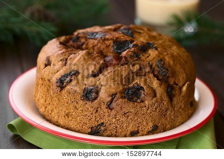 Traditional Chilean Pan de Pascua Christmas Cake made with spices dried fruits and raisins photographed with natural light (Selective Focus Focus on the front of the cake)