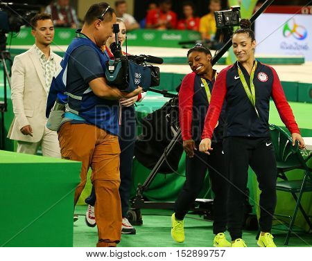 RIO DE JANEIRO, BRAZIL -AUGUST 11, 2016: Women's all-around gymnastics medalists at Rio 2016 Olympic Games Simone Biles of USA (L) and Aly Raisman of USA after medal ceremony at Rio Olympic Arena