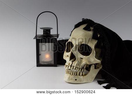 Skull and lantern isolated on grey background