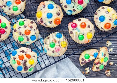 Shortbread cookies with multi-colored candy and chocolate chips on cooling rack horizontal top view