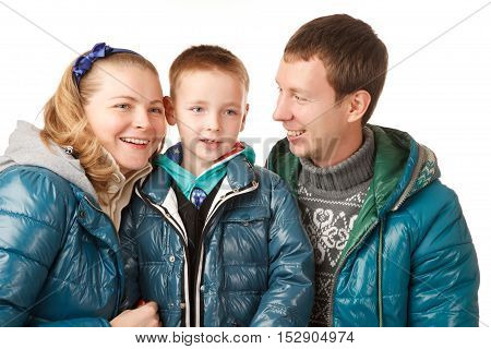 Happy FatherMother and Son on the White Background.They Dressed in Similar Warm Jackets