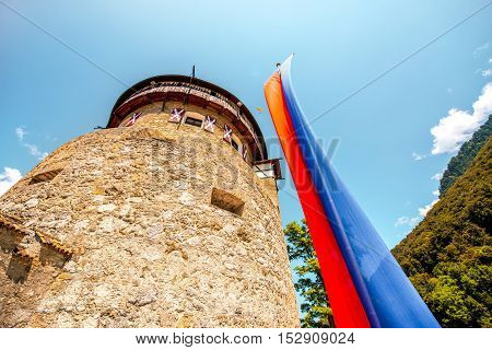 Vaduz, Liechtenstein - July 01, 2016: View on the tower with flag in Vaduz castle in the capital of Liechtenstein. This castle is the palace and official residence of the Prince of Liechtenstein